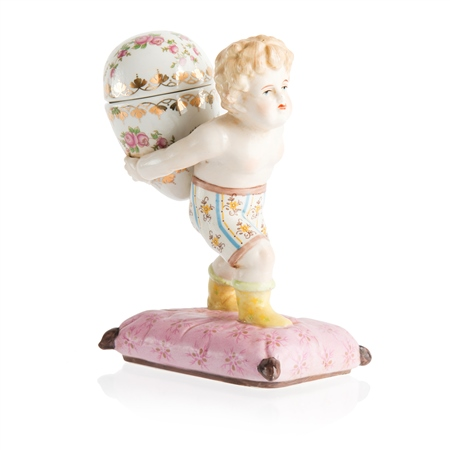 Porcelain Small Cherub Holding Egg  - Click to view a larger image